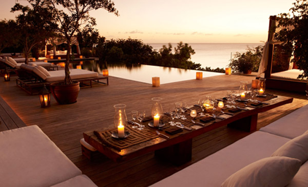 private-island-luxury-service-relaxation-turks-and-caicos_0001_parrotcay_bkg_pool_dining_sunset